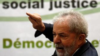 "Former Brazilian President Luiz Inacio Lula da Silva gestures as he attends a ""Democracy and social justice"" seminar in Sao Paulo, Brazil, April 25, 2016. REUTERS/Paulo Whitaker"