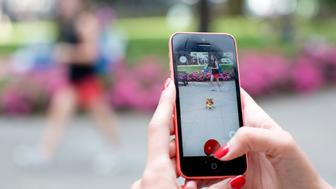 A girl plays Pokemon Go in the streets of London,  in July 25, 2016. UK is the fifth place worldwide where the mobile app is available to download.