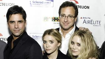 NEW YORK - NOVEMBER 09:  Comedian Seth Meyers, Caryn Zucker,comedian Colin Quinn,comedian John Stamos,actress Mary Kate Olsen, comedian Bob Saget, actress Ashley Olsen and comedian Jeff Ross attend Cool Comedy Hot Cuisine 2009 Benefiting The Scleroderma Research Foundation at Carolines On Broadway on November 9, 2009 in New York City.  (Photo by Shawn Ehlers/WireImage for Scleroderma Research Foundation)