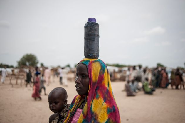 A woman carried her daughter to the nutrition clinic in Muna. Over 2 million people have been displaced...