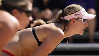 GLENDALE, AZ - SEPTEMBER 26:  Kerri Walsh (R) and Misty May-Treanor of USA during the round 3 match against Brazil in the AVP Crocs Tour World Challenge at the Westgate City Center on September 26, 2009 in Glendale, Arizona.  (Photo by Christian Petersen/Getty Images)