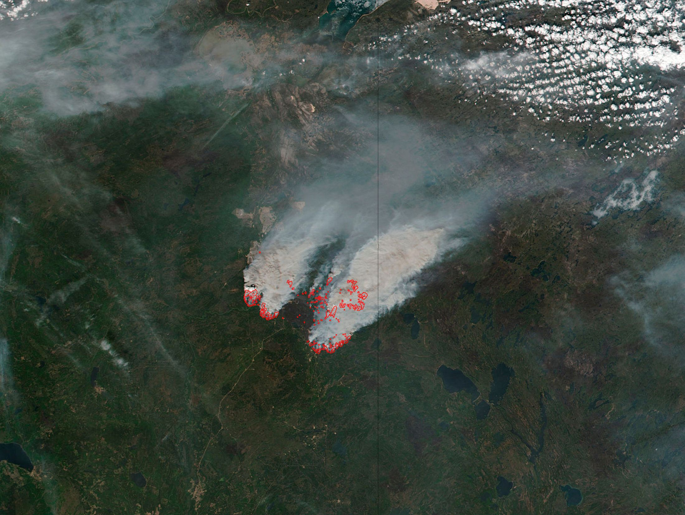 NASA's satellite image shows columns of smoke rising up from the myriad of wildfires, with NASA outlining actively burning areas in red over the Fort McMurray, Alberta, Canada on May 16, 2016.   Courtesy NASA/Handout via REUTERS  ATTENTION EDITORS - THIS IMAGE WAS PROVIDED BY A THIRD PARTY. EDITORIAL USE ONLY.  TPX IMAGES OF THE DAY