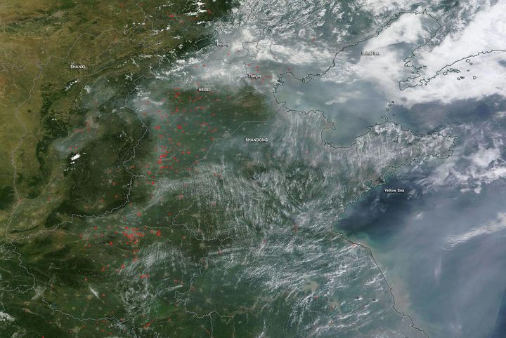 """On July 29, 2016, fires peppered the ground while smoke spread across the skies over eastern China. The Moderate Resolution"