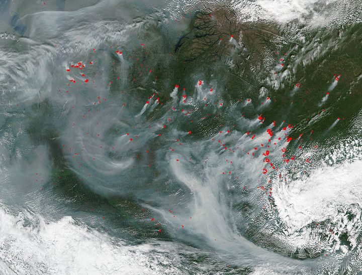 """Many wildfires continue pepper central Russia and created a portrait of swirling smoke in a satellite image. The Suomi NPP s"
