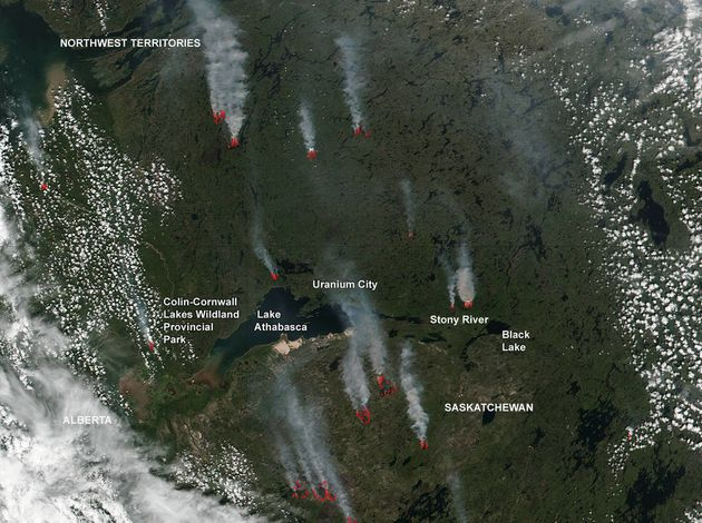 In this July 2, 2016 photo, fires are seen raging in northern Saskatchewan and the Northwestern Territories...