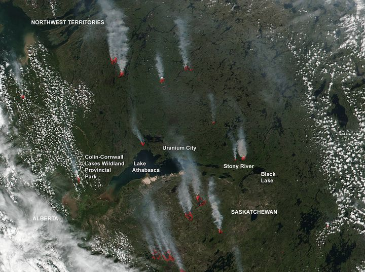 In this July 2, 2016 photo, fires are seen raging in northern Saskatchewan and the Northwestern Territories of Canada.