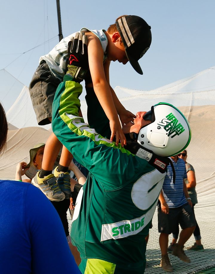 Skydiver Luke Aikins celebrates with son Logan after jumping 25,000 feet from an airplane without a parachute or wing suit on