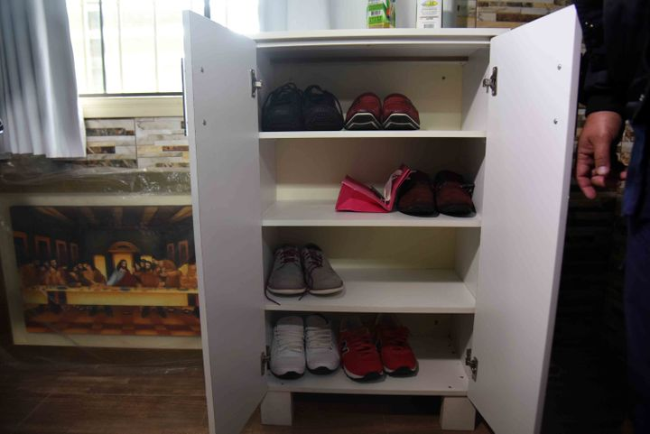 This photograph shows how he liked to store his footwear.