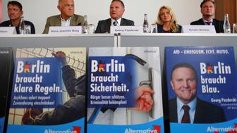 Georg Padzerski (C), top candidate of the anti-immigration party Alternative for Germany (AfD) for the Berlin state elections, attends a news conference in Berlin, Germany, July 28, 2016. REUTERS/Hannibal Hanschke