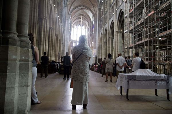 A Muslim woman attends a Mass in tribute to slain priest Jacques Hamel in the Saint-Denis Cathedral, France.