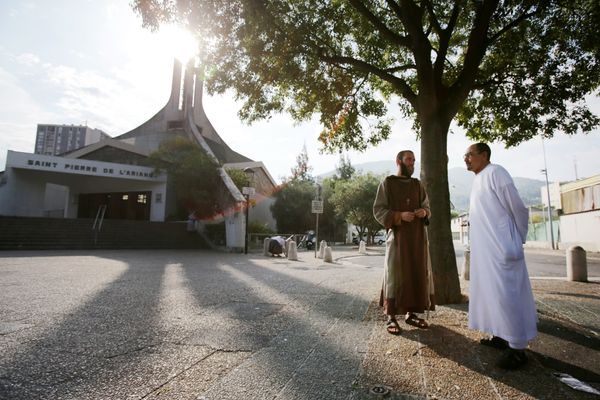 A Catholic monk and a Muslim worshipper in front of the Saint-Pierre-de-l'Ariane church in Nice, southeastern France.&nb