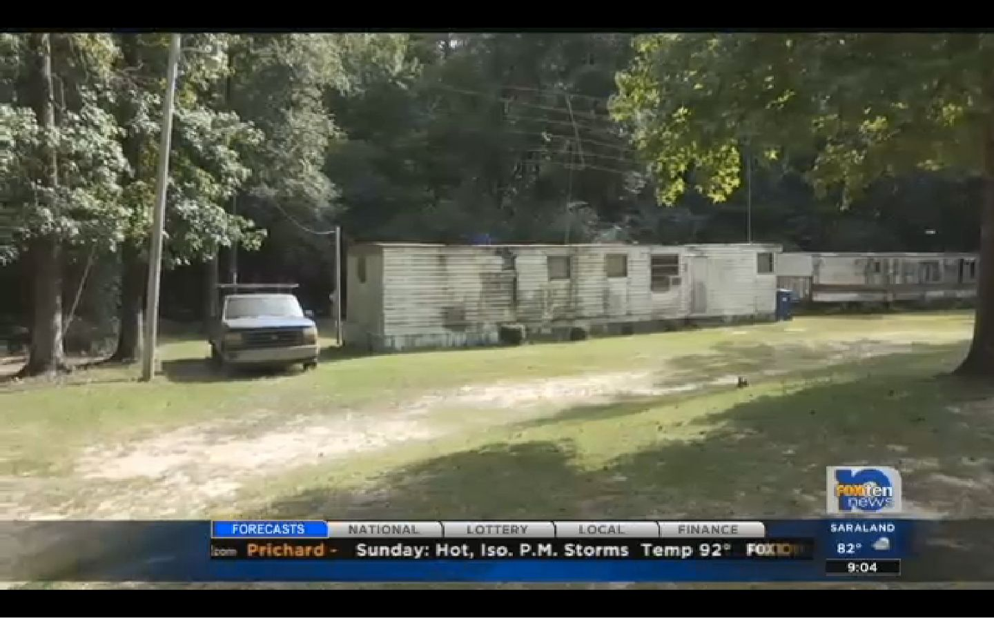 A 911 call about a thwarted break-in at this Mobile, Alabama home led to the discovery of a dead man taped to a tree.