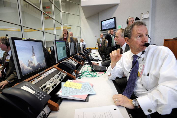 <i>NASA administrator Michael Griffin turns from his console to watch the liftoff of space shuttle Atlantis through the windo