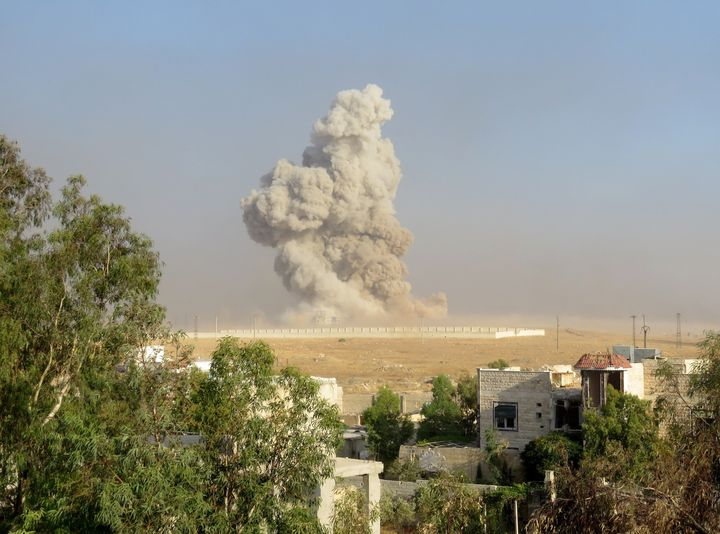 Smoke rises after anti-regimist opposition forces hit Assad regime forces' base in Aleppo.