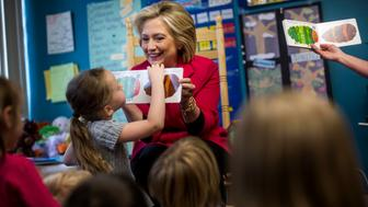 ROCHESTER, NEW HAMPSHIRE - JUNE 15:  Former Secretary of State Hillary Clinton reads 'Very Hungry Caterpillar' to a pre-k class talks at YMCA in Rochester, New Hampshire on Monday, June 15, 2015. (Photo by Melina Mara/The Washington Post via Getty Images)
