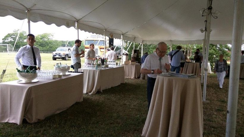 Pre-dinner cocktails are served in a tent on the school's 13-acre rural grounds.