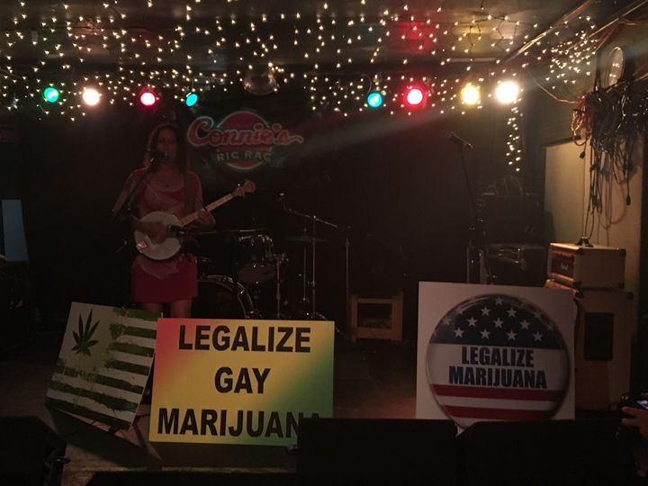 "Emily Yates sings an antiwar ballad at the ""DNC Marijuana Welcome Party"" at Connie's Ric Rac on July 25."