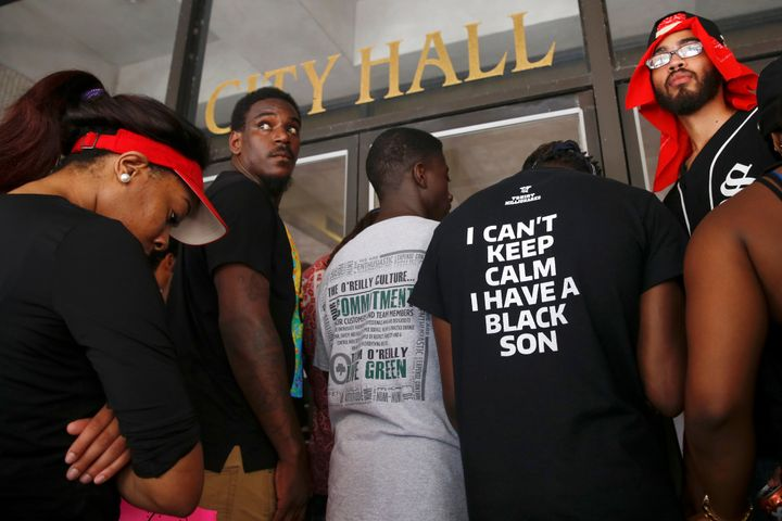 Demonstrators protesting the death of Alton Sterling stand in front of the East Baton Rouge Parish City Hall doors in Baton R