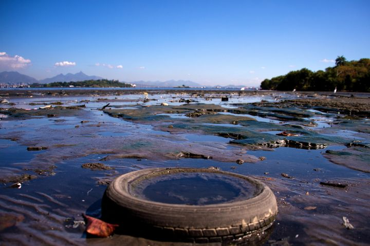 Debris sits near the shoreline of the polluted waters of Guanabara Bay between the cities of Rio de Janeiro and Niteroi on Ju