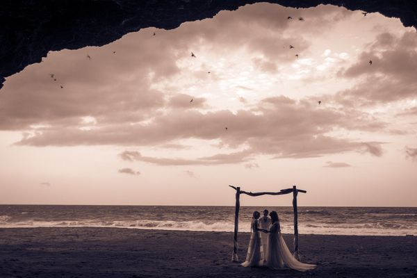 """""""Chloe and Kyla were married at sunset in Swallow Cave on the beach at Royal Isabela in Puerto Rico. When they ki"""