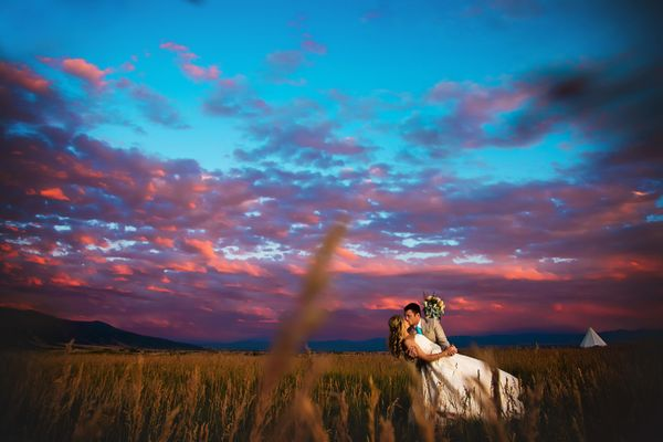 """""""Mike and Lena got married with an epic Montana sky on July 23 at the Big Yellow Barn in Bozeman."""" --<i>Sarah Notarius<"""