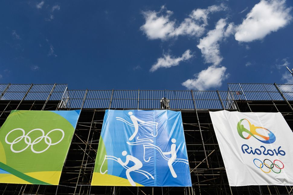 Banners hang on a structure at the Olympic Equestrian Centre in Rio de Janeiro. Brazilians are conflicted about their country