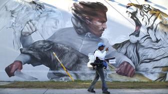 MIAMI, FL - JULY 30:  Sharon Nagel, a Miami-Dade County mosquito control inspector, walks through the Wynwood neighborhood looking for mosquitos or breeding areas where she kills the mosquitos with larvicide granules or a fogger spraying pesticide as the county fights to control the Zika virus outbreak on July 30, 2016 in Miami, Florida. There have been a reported four individuals that have been infected with the Zika virus by local mosquitoes which makes them the first known cases of the virus being transmitted by mosquitoes in the continental United States.  (Photo by Joe Raedle/Getty Images)