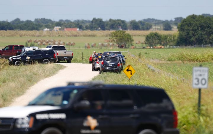 Authorities investigate the site in Maxwell, Texas where a hot air balloon crash killed 16 people on July 30, 2016. The pilot
