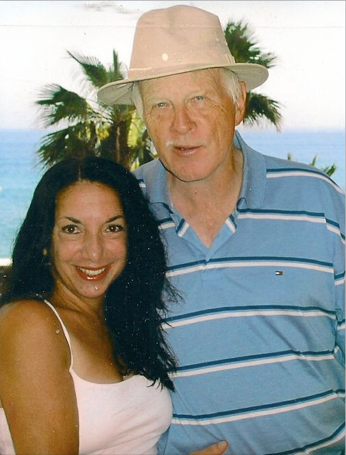The author and her husband on a vacation before his illness.