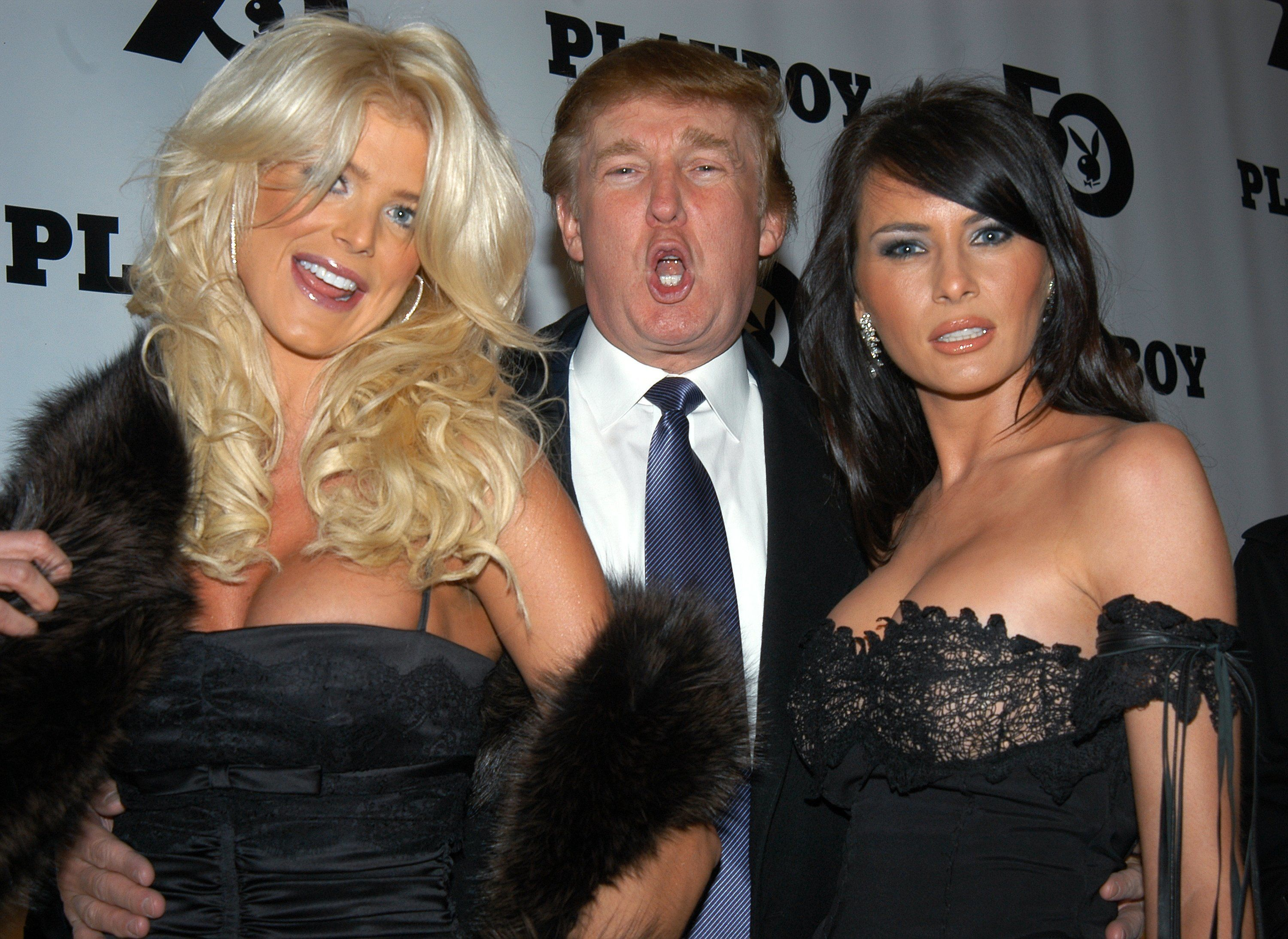 UNITED STATES - DECEMBER 05:  Donald Trump is flanked by Victoria Silvstedt, 1997 Playmate of the Year, and his girlfriend, Melania Knauss, at Playboy magazine's 50th anniversary celebration at the Lexington Ave. armory.  (Photo by Richard Corkery/NY Daily News Archive via Getty Images)