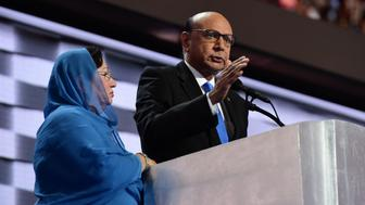 Khizr Khan (R), accompanied by his wife Ghazala Khan (L), speaks about their son US Army Captain Humayun Khan who was killed by a suicide bomber in Iraq 12 years ago,  on the final night of the Democratic National Convention at the Wells Fargo Center, July 28, 2016 in Philadelphia, Pennsylvania.    / AFP / Robyn BECK        (Photo credit should read ROBYN BECK/AFP/Getty Images)