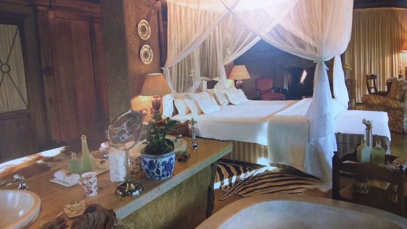 Curtained bed in a suite bedroom