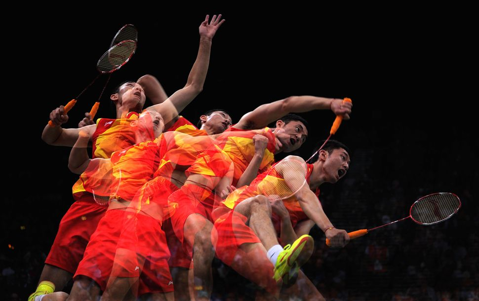 A Chinese badminton player smashes the shuttlecock atthe London 2012 Olympics.
