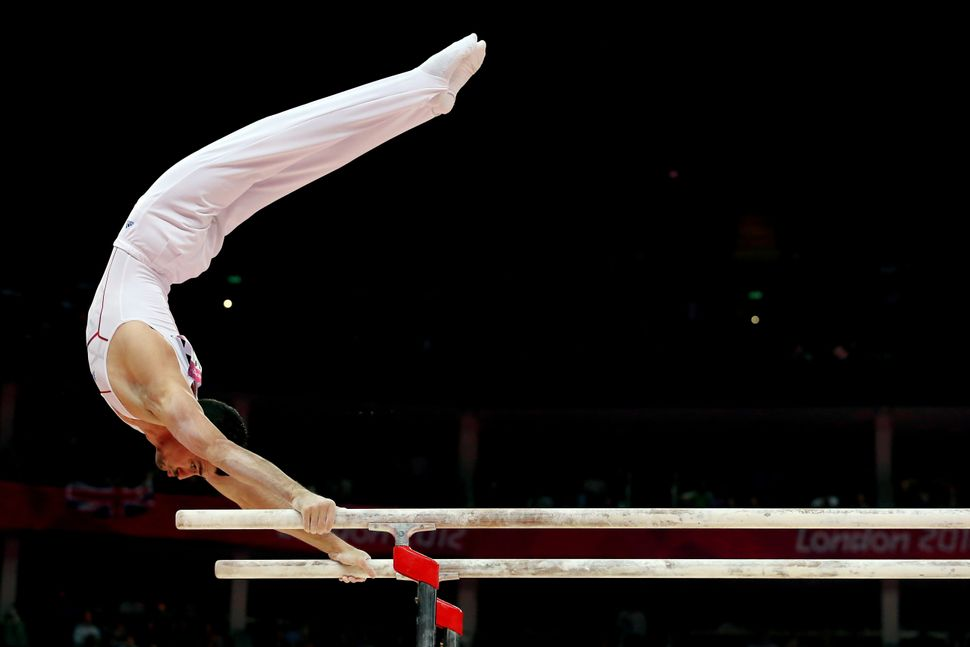 A French gymnast competes on the parallel bars atthe 2012 London Olympics.