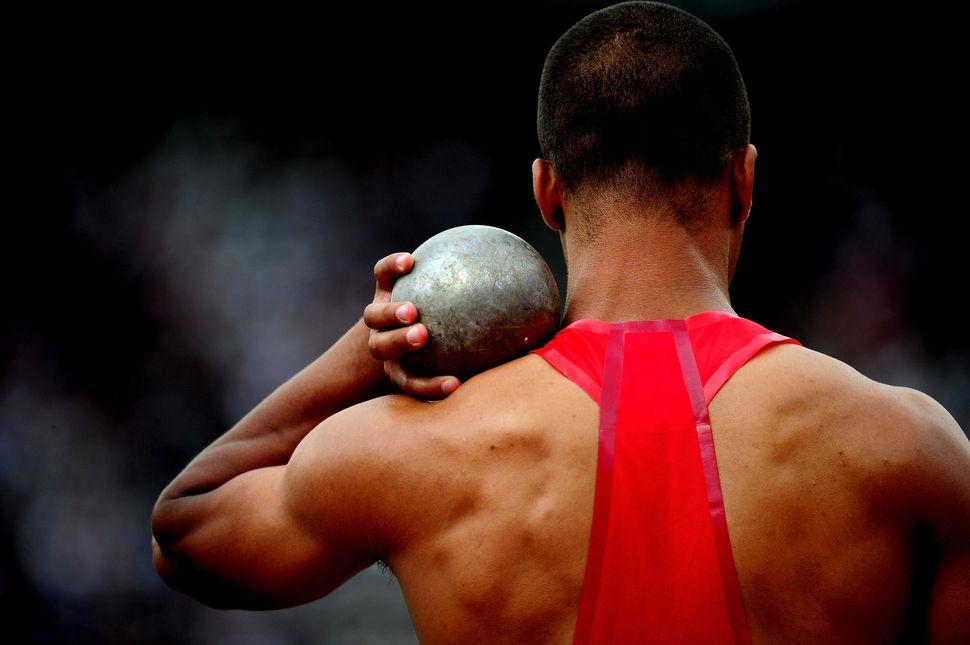 Ashton Eaton (USA) competes in the men's decathlon shot put atthe London 2012 Olympic Games.