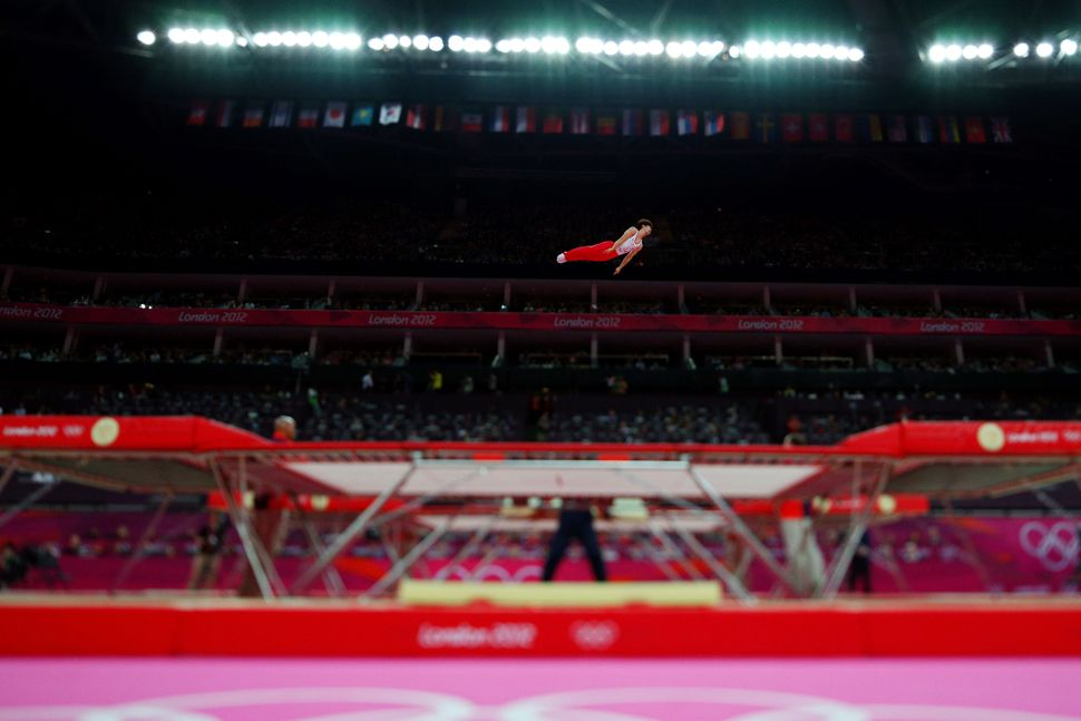 A Japanese gymnast competes on the trampoline atthe London 2012 Olympics.