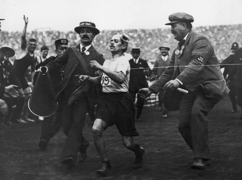 An Italian runneron the verge of collapse atthe London 1908 Olympics.