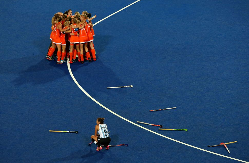The Netherlands field hockey team celebrates after winning the gold medal atthe London 2012 Olympics.