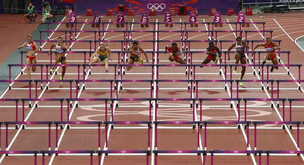 A wideview of the women's 100m hurdles final atthe London 2012 Olympics.