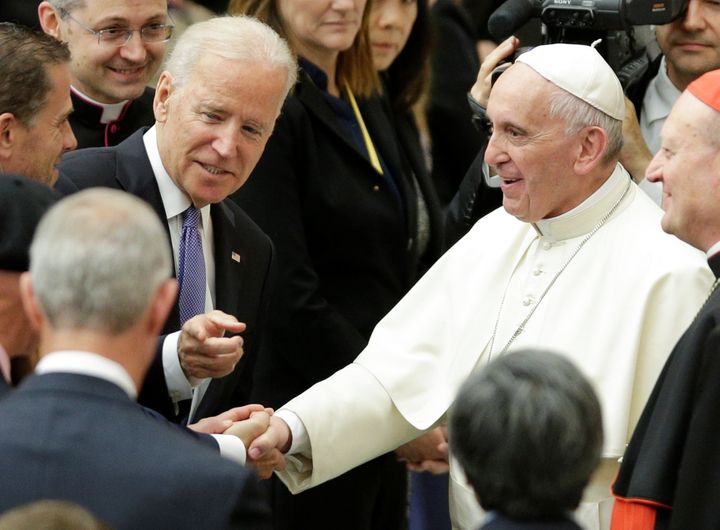 Vice President Joe Biden talks with Pope Francis in Paul VI hall at the Vatican on April 29, 2016.