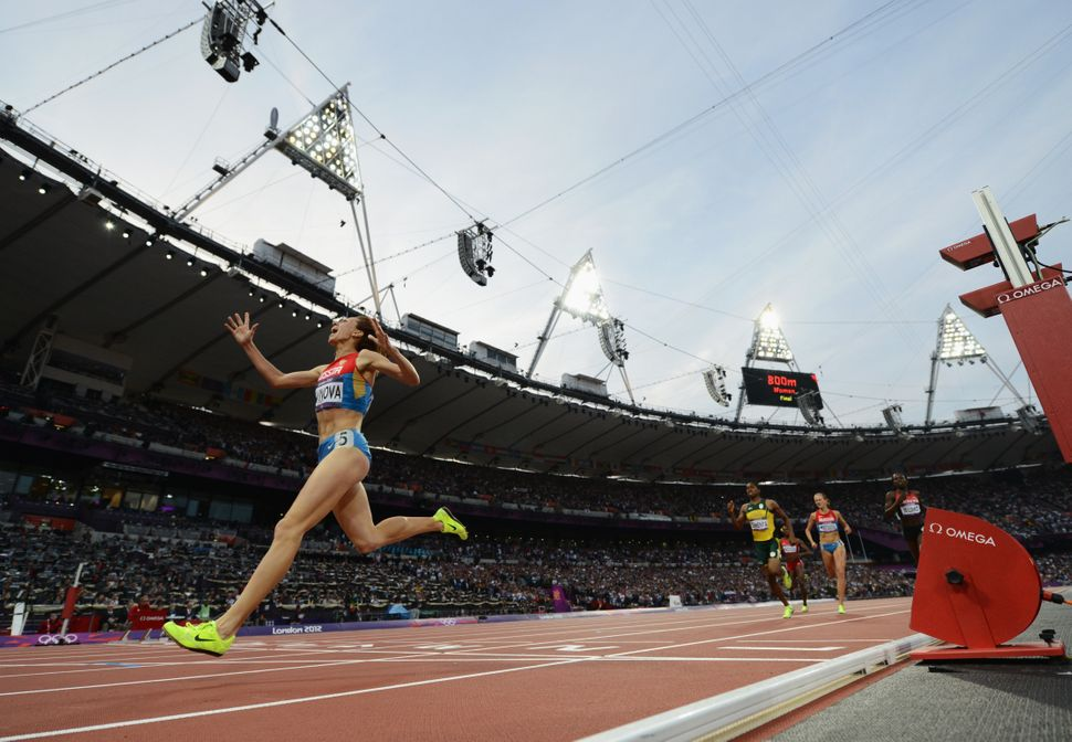 A Russian runnercelebrates as she wins gold atthe London 2012 Olympics.