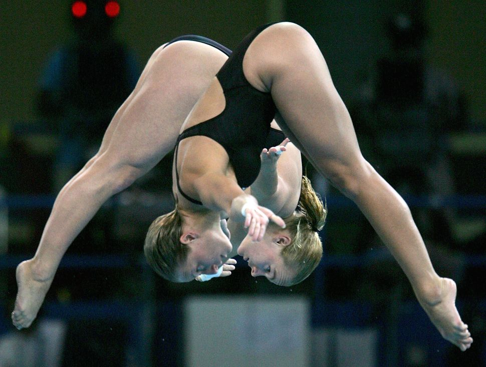 Team Canada competes in the women's 10 meter synchronized diving event at the 2004 Olympics.