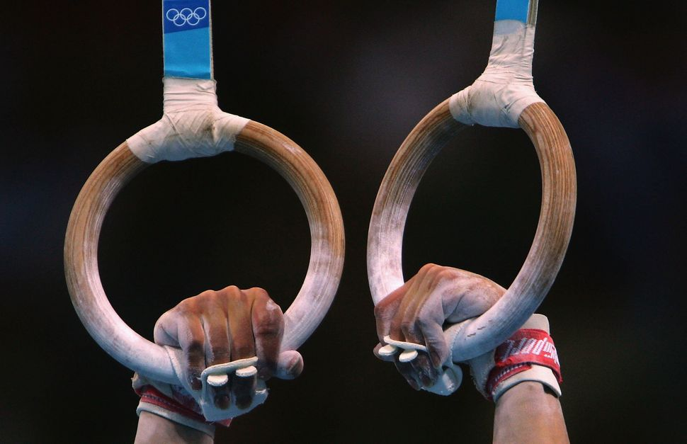 A gymnast's hands as he prepares to compete at the 2004 Summer Olympics.