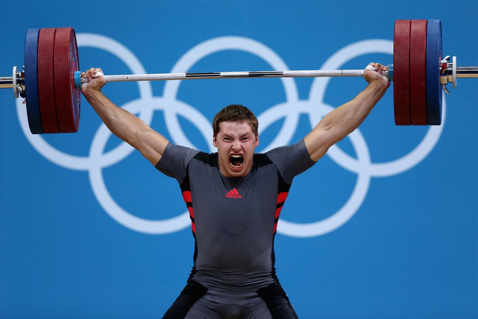 A Ukrainian weightlifter competes in the men's 105kg at the London 2012 Olympics.