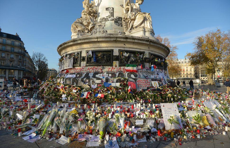 This photo taken on November 26, 2015 shows a makeshift memorial at Place de la Republique in Paris.