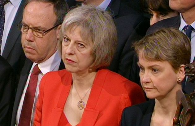 Theresa May (centre) was branded a 'complete disgrace' by Yvette Cooper