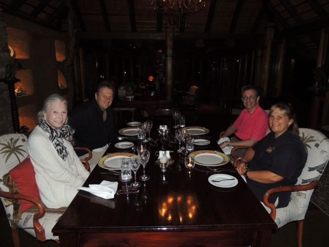 Guests enjoy a candlelit dinner in camp