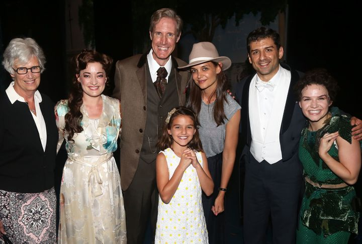 "Katie Holmes, Suri Cruise and family pose with cast and crew of ""Finding Neverland"" backstage in New York City."