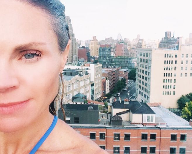 """Taking in the view from the rooftop pool during a stolen moment alone.&nbsp;<a href=""""https://presentperfectsite.com/"""" target="""