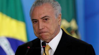 "Brazil's interim President Michel Temer reacts during ceremony for the new rules of the program ""Minha Casa Minha Vida"" at the Planalto Palace in Brasilia, Brazil July 14, 2016. REUTERS/Ueslei Marcelino"